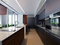 Love this minimalist kitchen with white counter tops.