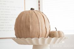 Give your fall decor a dose of pretty texture with this fun and easy pumpkin craft using Mod Podge and burlap ribbon!