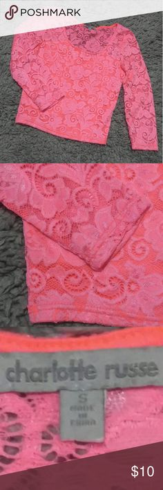 Bright Neon Pink Top Long Sleeve top, it kind of fits like a crop top, but a little longer. The sleeves and the back are see through, refer to last picture. It's a size Small, used but in good condition. Charlotte Russe Tops