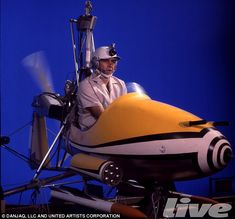 Sean Connery in 'Little Nellie' (minus rotor) in front of bluescreen doing close-ups for 'You Only Live Twice'. Note pitot, .30 cal mounting and A/A rockets