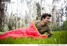 A man lays in his sleeping bag.