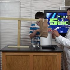 """It's invisible, it's in your soda, you even breathe it out, so what is it? Jason Lindsey aka """"Mr. Science"""" with Hooked on Science and a kid scientist show us by using a gassy seesaw. Go to http://www.hookedonscience.org/nextgenerationsciencestandards.html for the FREE NGSS experiment guide."""