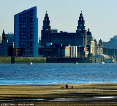 Liverpool city centre across the Mersey from the shore of New Brighton