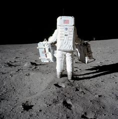 Nasa Edwin 'Buzz' Aldrin carries experiments for deployment on the lunar surface. July (Source: NASA) - Edwin 'Buzz' Aldrin carries experiments for deployment on the lunar surface.