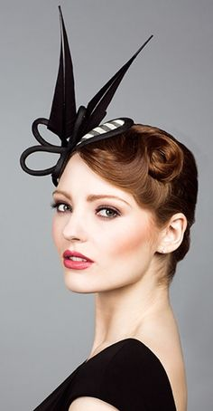 Rachel Trevor Morgan, S/S 2014. Stripe straw headpiece with arrows feathers.