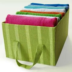 There's no need to purchase expensive baskets or other organizers when a fresh coat of fabric can tu... - Courtesy of handimania.com