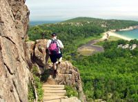 A hiker on one of Acadia National Park's huge network of hiking trails and carriage roads, where vacationers can also bike, and then camp at one of the park's campgrounds.