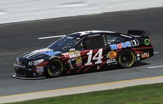 Tony Stewart Photos - Tony Stewart drives the #14 Mobil 1 Chevrolet during practice for the NASCAR Sprint Cup Series Camping World RV Sales 301 at New Hampshire Motor Speedway on July 12, 2013 in Loudon, New Hampshire. - New Hampshire Motor Speedway: Day 1