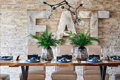 A home's modern rustic design is complemented with greenery and hits of cobalt for the holidays