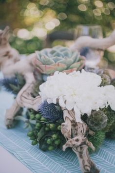 Modern driftwood succulent and wild flower wedding centerpieces