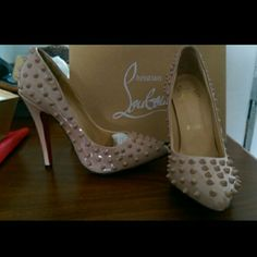 Spike red bottom heels Spike red bottom heels. Nude pink color. Brand new never worn. Price reflects authenticity. They say size 39 but fit a size 7-8 Shoes Heels