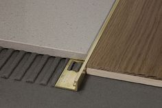Profinish in natural brass Profiles for floors of same height