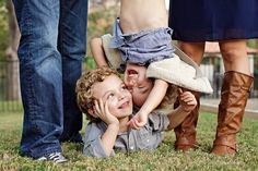 Upcoming family photo shoot idea...Finn and Layla between us and Shane dangling Tate.