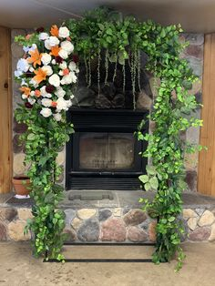 This is our rental arch already decorated with permanent botanicals. We worked in fresh blooms to corrdinate with the bouquets. Great indoor wedding arch.