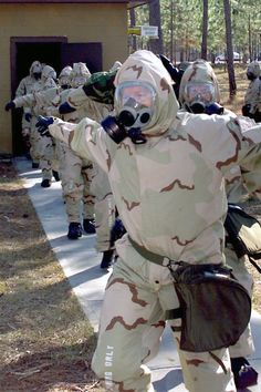 A group of U.S. Navy Seabees go through chemical biological and radiological (CBR) personnel decontamination training.