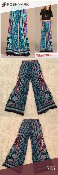 "Flying Tomato Palazzo Pants Perfect condition Flying Tomato palazzo pants. 100% rayon. Lightweight and super comfortable. Elastic waist with tassel. Size medium. 32"" inseam, 42"" outseam, 11"" rise, 13"" waist laying flat (18"" stretched). Smoke free home. Flying Tomato Pants Wide Leg"