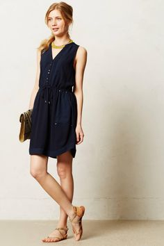 Danika's outfit 9: A sleveless navy shirtdress. The dress gives a glimpse of Danika's bralette. Book: Lovely Trigger.
