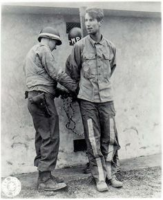 Manfred Pernass about to be executed by firing squad. He was one of 3 German soldiers caught during the Battle of the Bulge wearing American uniforms.