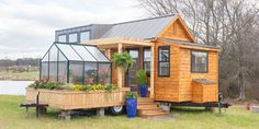 This Tiny House Comes With Its Own Porch Swing and Greenhouse