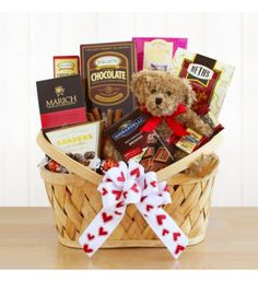 Bear with Chocolate Valentine Gift Basket Delight Your Valentine with this gift basket filled with sweets and the most adorable huggable teddy bear. A sweet gift for your Valentine.