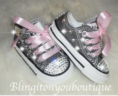 We are starting to custom adult sizes as well!   All shoes are original Converse brand and are made with beautiful  Authentic Swarovski crystals!  Show Stoppers!!! :)   These Beautiful shoes have bling all around the shoes!!  Infant size shipped in original box- Charcoal Gray Lots of Swarovski Crystals HAND placed.  please note the sliders are not Swarovski All Toddler sizes are available 2 week turn around time Sparkle and Shine Bright like a Diamond! :) Great for pageants! Great for Photo…