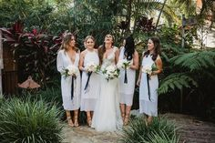 We've seen a huge trend in white bridesmaids dresses. From boho floating gowns to structured form fitting looks, these bridesmaids look fabulous!