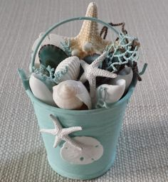 Beach Christmas Ornament, Beach Décor. These gorgeous pails have been hand painted in three colors, turquoise, aqua and blue. They have been given a distressed finish and then adorned with a beautiful arrangement of shells, starfish, tiny sand dollars, fishing net and tiny pieces of sea fan. They would make the the perfect addition to your Beach Christmas Tree, Beach Wedding Decor or displayed on a shelf or mantel for a pretty coastal look.  They could even be used as Beach Wedding Cake…