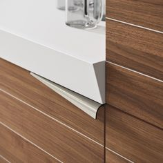 Linear walnut fitted kitchen TIME by Snaidero design Lucci Orlandini Design