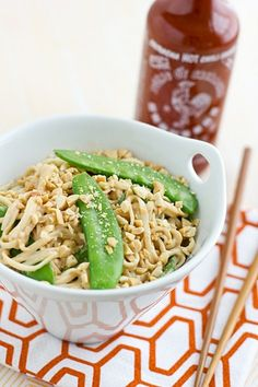 peanut udon noodles with snow peas    ingredients    8 oz. dried udon noodles  4 oz. snow peas, strings removed  1/2 c. natural peanut butter  2 tbsp. rice vinegar  1 tbsp. toasted sesame oil  2 tbsp. soy sauce  2 tsp. brown sugar (optional)  1 tsp. ginger, grated  1 garlic clove, minced  pinch of red pepper flakes or sriracha to taste (optional)