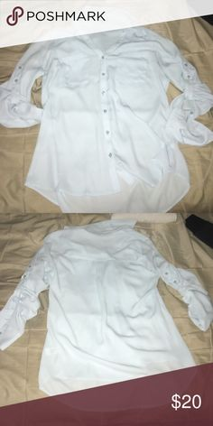 Express Button Up shirt! The color doesn't show very well in the picture, but it's a beautiful icy blue color. This has never been worn, just sitting in my closet. It is very silky and Foley, very cute. Express Tops Button Down Shirts