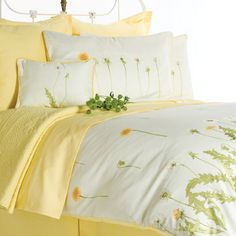 Brighten your bedroom with Harmonie. The yellow and floral motif  is cheerful and adds a touch of sunshine to your space.