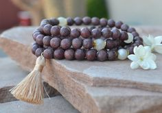 Check out this item in my Etsy shop https://www.etsy.com/listing/287451187/rosewood-mala-beads-wrist-mala-yoga