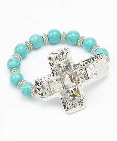 Love this Silver & Turquoise Cross Beaded Stretch Bracelet by Rhinestone Junkie on #zulily! #zulilyfinds