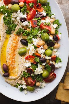 Loaded Hummus Is the Dreamiest Appetizer for Summer Parties Bring on the pita. Loaded Hummus Is the Dreamiest Appetizer for Summer Parties Bring on the pita. Clean Eating Snacks, Healthy Snacks, Healthy Eating, Clean Foods, Vegetarian Recipes, Cooking Recipes, Healthy Recipes, Vegan Vegetarian, Vegan Meals