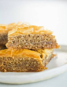 Baklava& strudel should be think many layer of flavoer.you flunged strudel when the baklalva Taller :: A classic recipe for the traditional Greek pastry made with ground nuts and layers of phyllo dough, drizzled with a spiced honey syrup. Greek Desserts, Köstliche Desserts, Delicious Desserts, Dessert Recipes, Dinner Recipes, Greek Pastries, Food Processor Recipes, Sweet Treats, Food And Drink