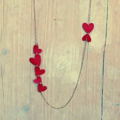 Necklace with red hearts - AMOUR. €25.00, via Etsy.