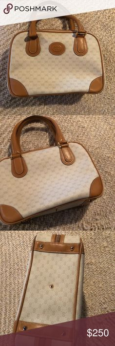 Vintage Gucci handbag Vintage authentic Gucci small handbag very good condition exterior and interior is in good condition with a quarter size stain inside zipper pocket shown in pic. Exterior has very little wear shown in pics . Gucci Bags
