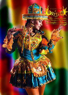 Kullawada - Folklore de Bolivia Los bailarines de kullahuada llevan como principal símbolo a la rueca (kapu en idioma aymara) en las manos como símbolo, las mujeres llevan una pollera, una pechera bordada, una manta llamada lliclla y unas bolsas atadas en la cintura. La vestimenta de los hombres consta de un sobrero llamado kh'ara y un ponchillo bordado. Es una de las 18 especialidades de baile del Carnaval de Oruro - Bolivia en devoción a la Virgen del Socavon.