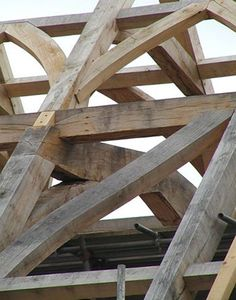 A detail of the new timber-framed roof structure with its elegant wind braces