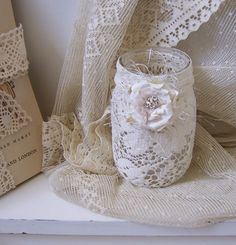 mason jar vintage laces candle holder with flameless candle included. $12.00, via Etsy.  Maybe something similiar to this.