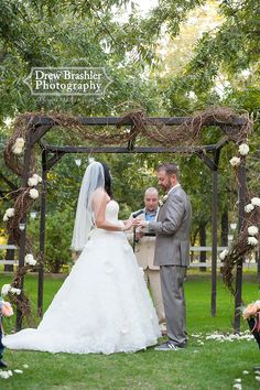 Venue at the Grove- Arbor twigs, branches, and flowers.