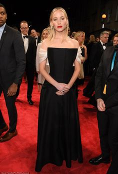 Exquisite: She wore a one-colour gown that featured elegant white sleeves... #jenniferlawrence