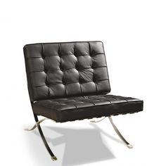 Sillón acolchado a cuadros y estructura de acero plano cromado. Este sillón es un clásico del diseño del siglo XX.