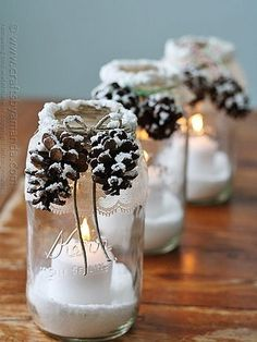 Light up your mantel or front porch with these easy Mason jar votives—all you need is a jar of snow texture paint, lace, twine, Epsom salt, and pinecones, natch.Christmas Decor=made!