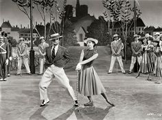"""Gene Kelly & Leslie Caron in """"An American in Paris"""" (1951)."""