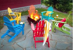 Give your yard a mountain-inspired makeover with Adirondack furniture. Classic chairs offer a casual space to lounge, while side tables let you keep beverages within reach. To take your style to new heights, assemble an array of colorful seats around the firepit for a festive feel.