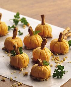 8 tablespoons smoked Cheddar cold pack cheese food , well chilled chopped peanuts 4 butter-flavored pretzel spindles or sticks  fresh parsley leaves. Refrigerate 10 to 15   2. With end of toothpick, draw ridges around balls to resemble pumpkins. Dip bottoms of cheese balls in chopped peanuts, insert pretzel halves into cheese balls for pumpkin stems. Decorate with parsley