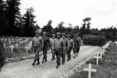 Honorary pallbearers at Roosevelt's funeral include Bradley and Lieutenant General George S. Patton at the head of the column on the left, a...