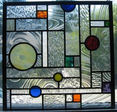 Geometric stained glass window via Etsy
