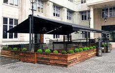Vinyl Pergola Attached To House - - - Pergola Garten Mauer Outdoor Restaurant Design, Deco Restaurant, Pergola Attached To House, Pergola With Roof, Black Pergola, Steel Pergola, Corner Pergola, Covered Pergola, Rustic Pergola